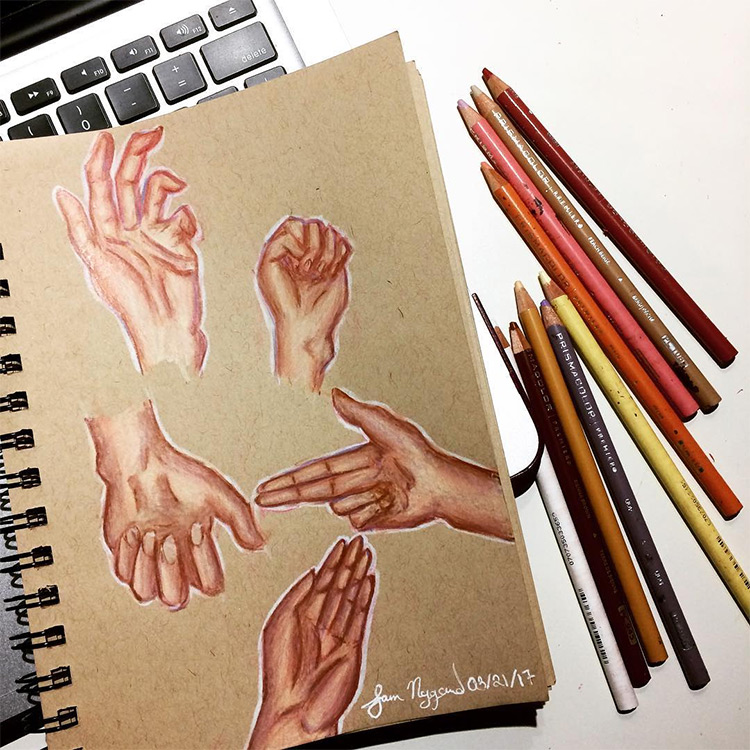 Drawings of hands on toned paper