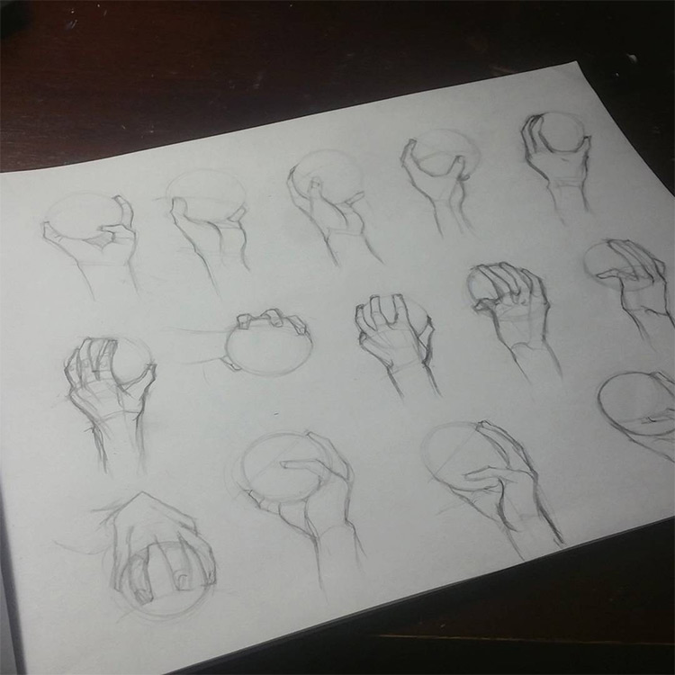 Drawings of hands holding balls