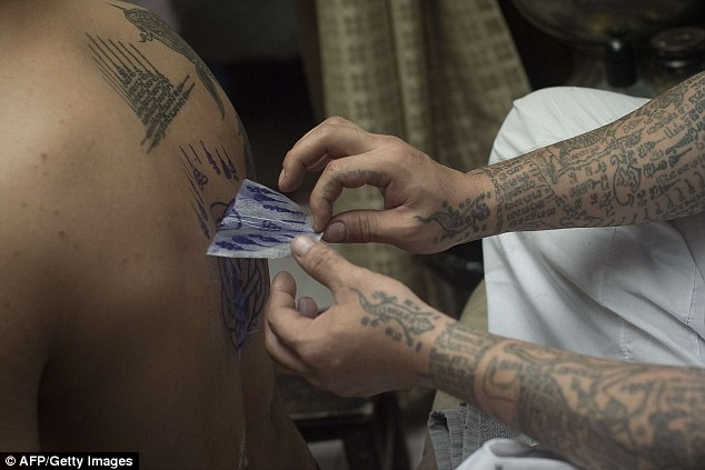 Some groups in Thailand want a complete ban on any tattoos of religious figures
