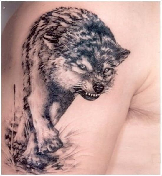 wolf tattoo on upper arm